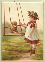 child standing to pet puppy on swing