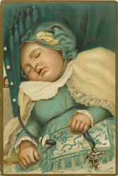 baby sleeping with soother hanging to side and rattle in other hand