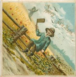 boy waving wooden ax sitting on fence