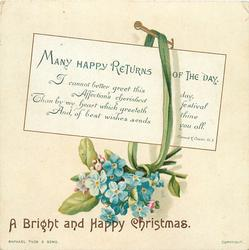 bouquet of small blue flowers hang from nail with greeting card