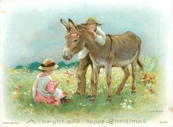 donkey stands with boy leaning against him, girl in pink and white sits in front