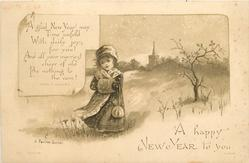 little girl in winter coat, hat, and muff walks by small tree, church in distance