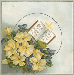 book and cross on bouquet of purple and yellow flowers