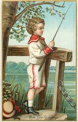 child stands on steps to water and holds fishing rod