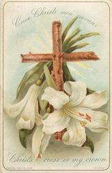 cross with open white lily and two smaller buds