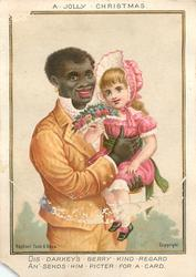 black man in yellow suit holds girl in pink dress