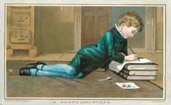 boy in fancy blue clothing lying on floor colouring