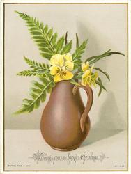 yellow pansies and ferns in brown jug