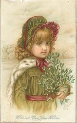 child in green coat and hat, purple ribbons and white fur cape holds mistletoe