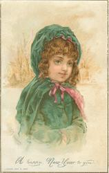 child in green coat and cape with red ribbon