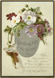light purple and white fowers and foliage above silver Easter egg