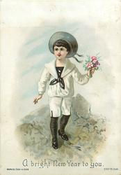 boy holding bouquet of flowers