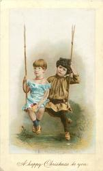 boy and girl sit on swing