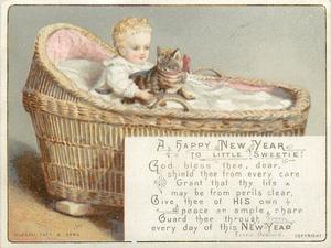 baby sits and holds two toned brown striped kitten with red ribbon