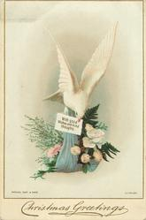 dove carrying bouquet of flowers with gift tag