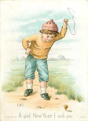 boy with spinning top