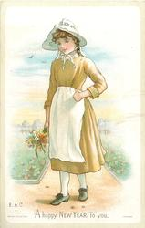 girl in green dress with white hat and apron holds flowers in her right hand