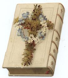 floral cross on bible