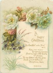 flowers draped over sheet of paper with greeting