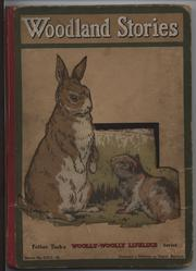 WOODLAND STORIES rabbit on hind legs with another lying on ground before it