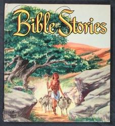 BIBLE STORIES boy leads sheep allong a rocky path under large tree