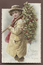 young man holds stick with bunches of holly leaning against his left shoulder