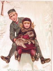 children sleighing on tobogan