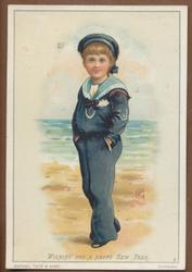 boy in sailor suit stands with hands in pockets