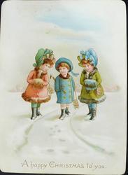 three children walk in snow