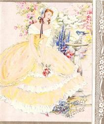 BIRTHDAY WISHES lady in yellow dress stands in garden, bluebird on sundial
