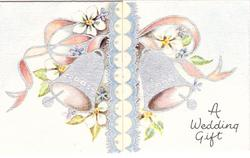 A WEDDING GIFT two silvered bells, white flowers and pink ribbon