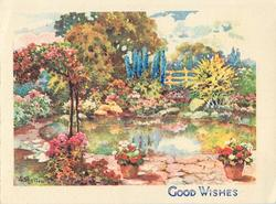 GOOD WISHES bountiful flower garden surrounds pond, trees behind, two potted plants front