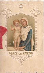 PEACE ON EARTH inset Baby Jesus stands on table, Mary in blue dress at his side, embossed design with stylised lilies, cream background