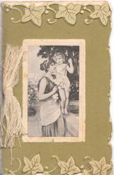 no front title, stylised ivy leaves above & below, woman stands holding child standing on wall, green background
