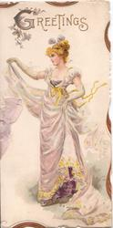GREETINGS in gilt above blonde woman standing holding up her skirt, facing left