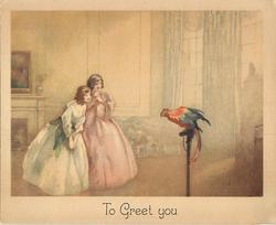 TO GREET YOU two girls wearing old style dresses stand in parlour looking at brightly coloured parrot, muted background