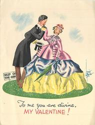 TO ME YOU ARE DIVINE, MY VALENTINE! elaborately dressed couple stand on circle of grass, sign left reads KEEP OFF GRASS