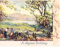 A JOYOUS BIRTHDAY rural scene, couple work near wooden fence, trees right, water & mountains behind, panel of branches right