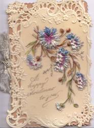 A HAPPY CHRISTMAS TO YOU on cream celluloid front at base below blue cornflowers, very elaborate marginal design