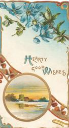 HEARTY GOOD WISHES (H & W illuminated) in gilt below blue anemones & circular design with winter watery inset