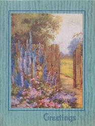 GREETINGS in blue below,  floral garden in front of wooden fence with open gate, tall blue flowers behind smaller pink & purple ones