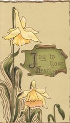 JOY TO YOUR HEART on green plaque