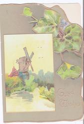 GOOD WISHES in gilt, exaggerated ivy and inset of windmill