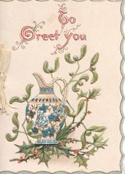 TO GREETI YOU(T,G & Y illuminated) above tall blue & white pot around  berried  holly & mistletoe, 3 narrow blue margins