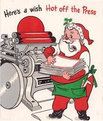 HERE'S A WISH HOT OFF THE PRESS Santa stands right of printing press