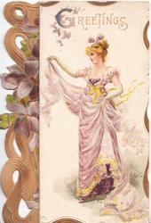 GREETINGS in gilt above blonde woman standing holding up her skirt, facing left, perforated brown design left