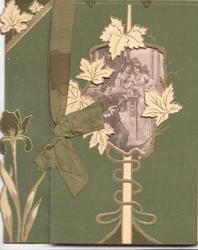 no front title, stylised leaf design round large perforation, green ribbon left, deep green background