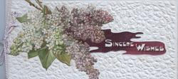 SINCERE WISHES in white, white & purple lilac left, heavily embossed white background