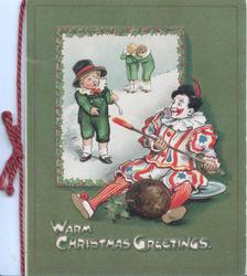 WARM CHRISTMAS GREETINGS in white below clown using red hot poker to defend his theft of Christmas pudding from 3 unhappy boys