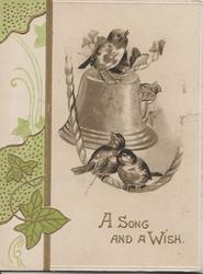 A SONG AND A WISH in gilt below 3 birds of happiness perched on rope & bell, stylized ivy design left